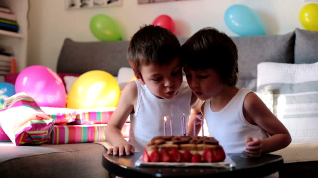 Sweet little children, boys, celebrating  sixth birthday, cake, balloons, candles, cookies. Childhood happiness concept video