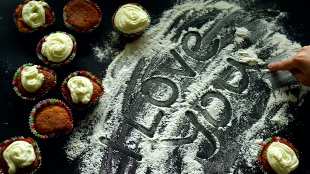 Sweet love concept. Inscription I love you on white flour kitchen background video
