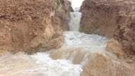 Swiftly flowing water in the soil niche. video