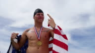 Swimmer celebrating with medal and American flag video