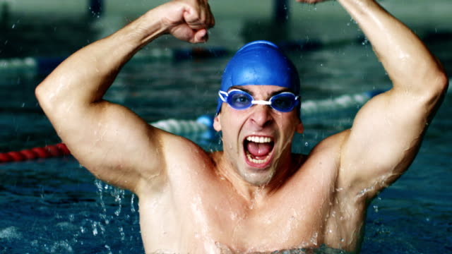 Swimmer cheering in the pool video