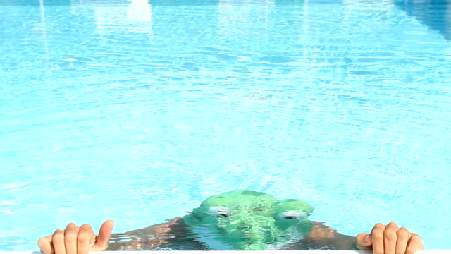 Swimmer in a Frog Costume video