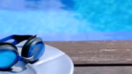 Swimming equipment on the edge of a swimming pool, dolly video