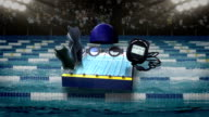Swimming icon, swimming race track, cap, stopwatch. video