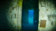 Swimming in the cabin of shipwreck undersea video