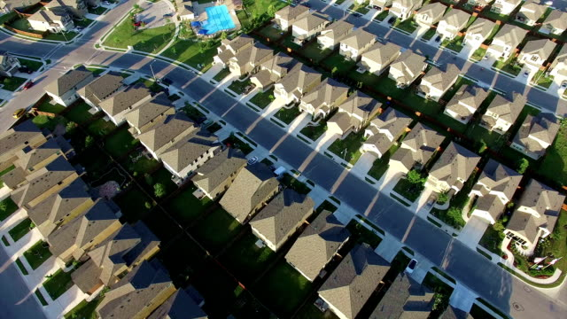 Swimming Pool at center of New Suburb Outside of Austin Texas near Round Rock aerial house after house after house video