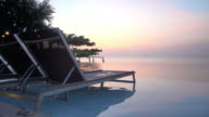 Swimming pool at sunset times video