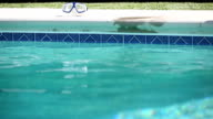 Swimming Pool Edge. Women Picks up Goggles video