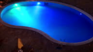 Swimming pool with night illumination video