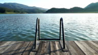 Swimming Stair pool in nature with lake and mountain view video