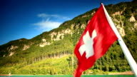 Swiss flag in foreground on lake Thun video