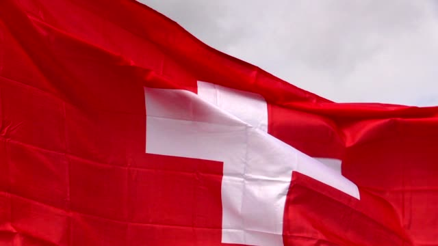 Swiss flag in the wind in sunlight video