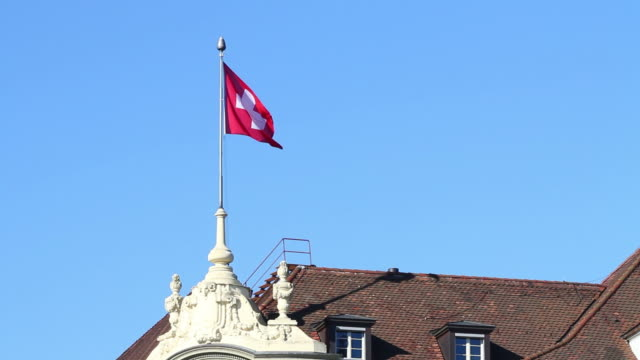 HD: Swiss Flag over a roof in Bern video