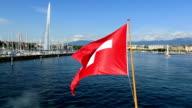 Swiss flag over Lake Geneva video