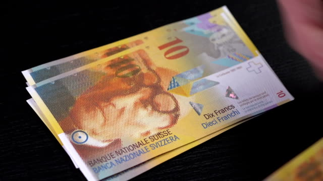 Swiss Franc counted on a table video