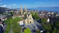 Switzerland aerial shot - flying over the church of Neuchatel video