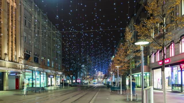 switzerland famous night illumination zurich traffic bahnhofstrasse panorama 4k time lapse video