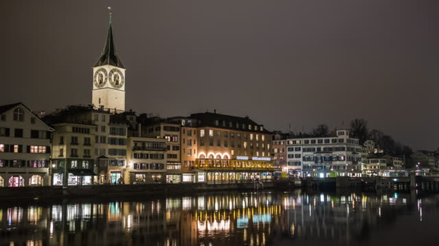 switzerland night light famous zurich limmat river side reflection panorama 4k time lapse video