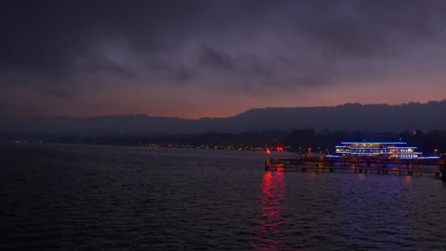 switzerland night twilight sky zurich famous lake ferry bay panorama 4k video