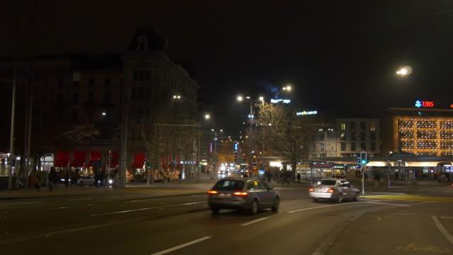 switzerland night zurich quaibrücke bridge bellevue station traffic crossroad panorama 4k video