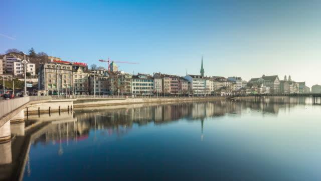 switzerland sunny day zurich cityscape river bridge side panorama 4k time lapse video