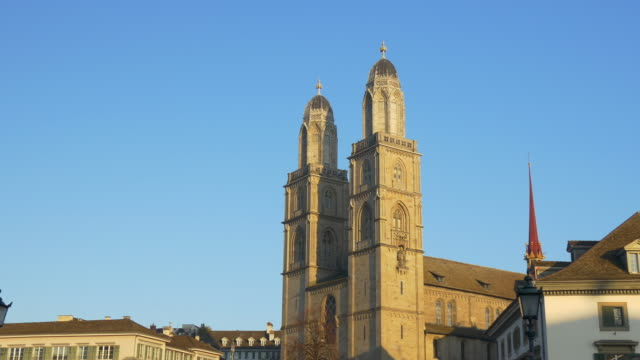 switzerland sunset time zurich grossmunster cathedral famous front panorama 4k video