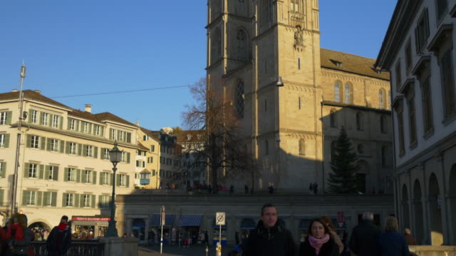 switzerland sunset time zurich grossmunster cathedral limmatquai panorama 4k video