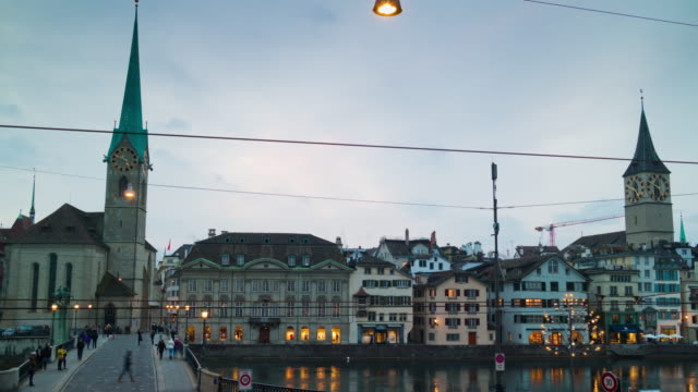 switzerland twilight famous zurich city fraumunster church limmatquai bridge panorama 4k time lapse video