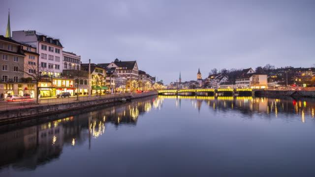 switzerland twilight zurich city famous limmat river bridge cityscape panorama 4k time lapse video