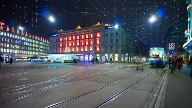 switzerland zurich city night holiday illumination paradeplatz tram traffic panorama 4k time lapse video