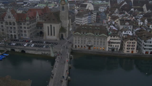 switzerland zurich grossmunster view point münsterbrücke river cloudy evening panorama 4k video