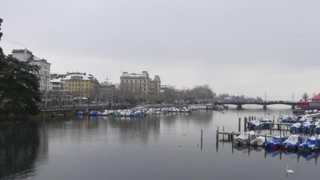 switzerland zurich limmat river quaibrücke bridge limmatquai side winter day panorama 4k video