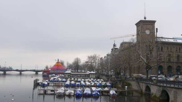 switzerland zurich limmat river quaibrücke yacht dock bridge winter day panorama 4k video
