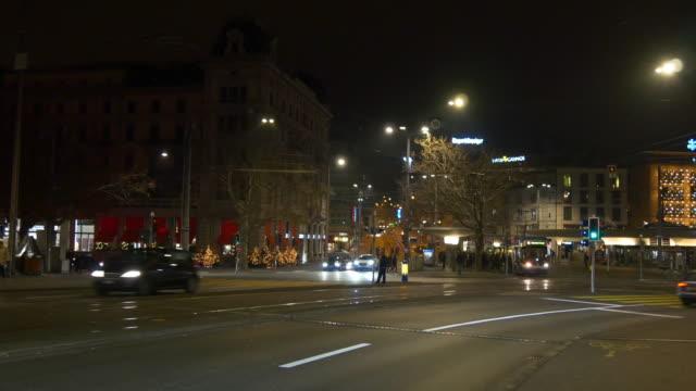 switzerland zurich quaibrücke bridge bellevue station traffic crossroad night panorama 4k video