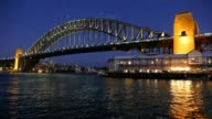 Sydney Harbour Bridge on dusk with Sydney Pier and Sydney Wharf in View video
