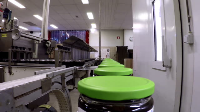 Syrup jars on a production line video