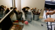 table in a beauty salon. Professional brushes and powder boxes video