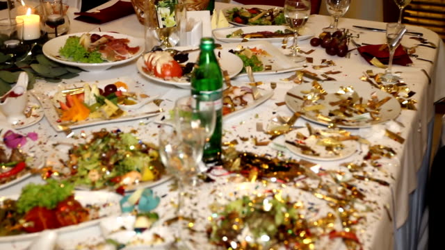Table in restaurant completely in confetti video