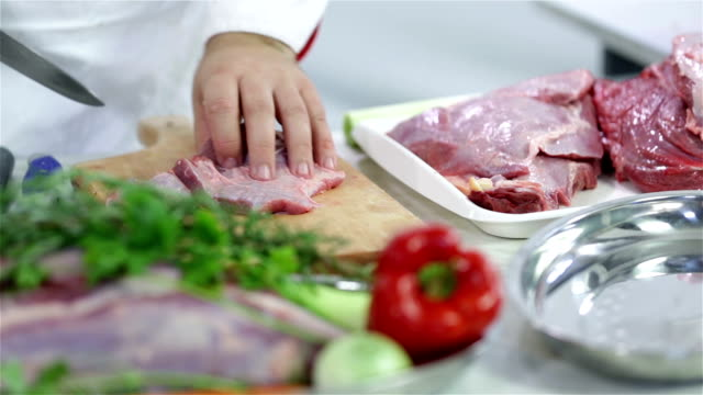 HD: Table of red meat and cutting to pieces video