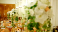 Table with bouquets of flowers video