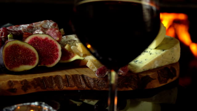 Table with hors d'oeuvres and wine video