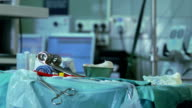 Table with medical tools in operating room video