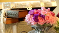 Tables decorations of flowers and trunk. Dynamic change of focus. Close up video