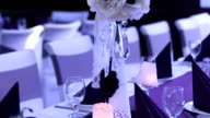 Tables with centerpieces at wedding reception video