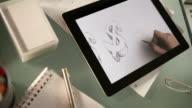 Tablet drawing dollars video