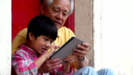 Tablet Grandfather and Grandson video