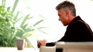 Tablet man, and coffee break. video