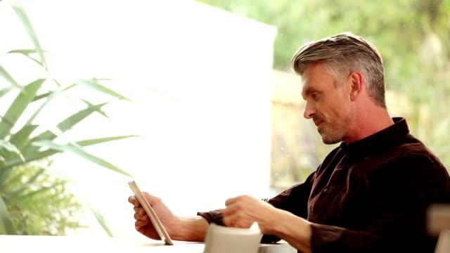 Tablet man, relaxing. video
