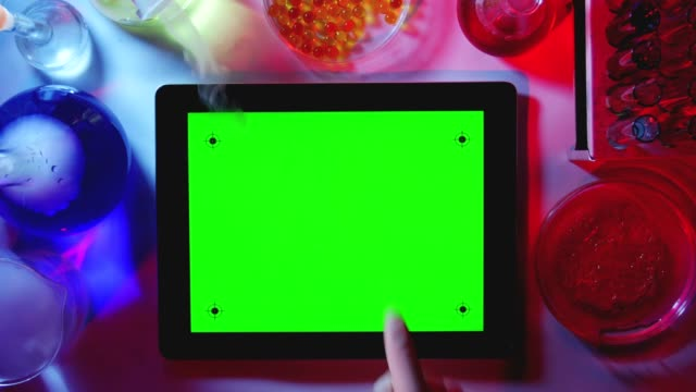 Tablet PC with a Green Screen in the Laboratory.Top View. video