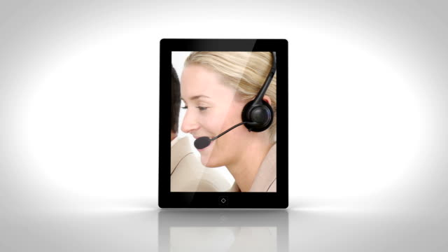 Tablet showing business people working video